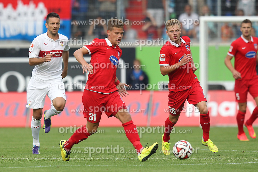 26.07.2014, Voith Arena, Heidenheim, GER, FS Vorbereitung, Testspiel, 1. FC Heidenheim vs VfB Stuttgart, im Bild Florian Niederlechner (1.FC Heidenheim) Hintergrund Links Vedad Ibisevic ( VfB Stuttgart ) rechts Marcel Titsch-Rivero (1.FC Heidenheim) // during a Friendly Match between 1. FC Heidenheim and VfB Stuttgart at the Voith Arena in Heidenheim, Germany on 2014/07/26. EXPA Pictures &copy; 2014, PhotoCredit: EXPA/ Eibner-Pressefoto/ Langer<br /> <br /> *****ATTENTION - OUT of GER*****