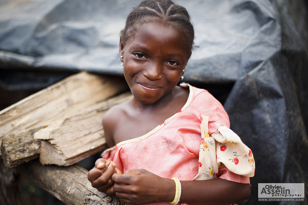 Portrait of a girl on a cocoa plantation near the town of Moussadougou, Bas-Sassandra region, Cote d'Ivoire on Monday March 5, 2012.