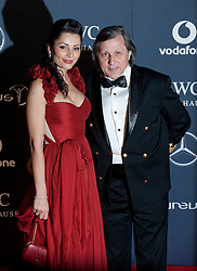 © Licensed to London News Pictures. 06/02/2012. London, UK. Ilie Nastase and guest  arriving on the red carpet for the Laureus World Sports Awards 2012. Dozens of sports and Hollywood celebrities arrived in the English capital to attend the event held at the Queen Elizabeth II Conference Centre in the same year that London will host the Olympic Games. Photo credit : Ben Cawthra/LNP