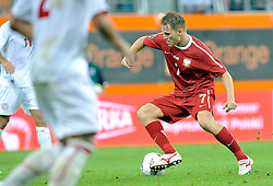 (R) Eugen Polanski of Poland controls the ball during friendly soccer match between Poland and Georgia in Lubin, Poland...Poland, Lubin , August 10, 2011..( Photo by © MEDIASPORT )..PICTURE ALSO AVAIBLE IN RAW OR TIFF FORMAT ON SPECIAL REQUEST.