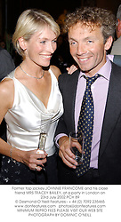Former top jockey JOHNNIE FRANCOME and his close friend MRS TRACEY BAILEY, at a party in London on 23rd July 2002.	PCH 89