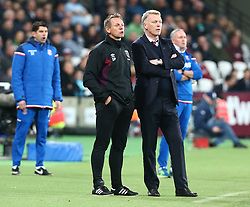 April 16, 2018 - London, England, United Kingdom - L-R West Ham United Joint Assistant manager Stuart Pearce  and West Ham United manager David Moyes .during English Premier League match between West Ham United and Stoke City at London stadium, London, England on 16 April 2018. (Credit Image: © Kieran Galvin/NurPhoto via ZUMA Press)
