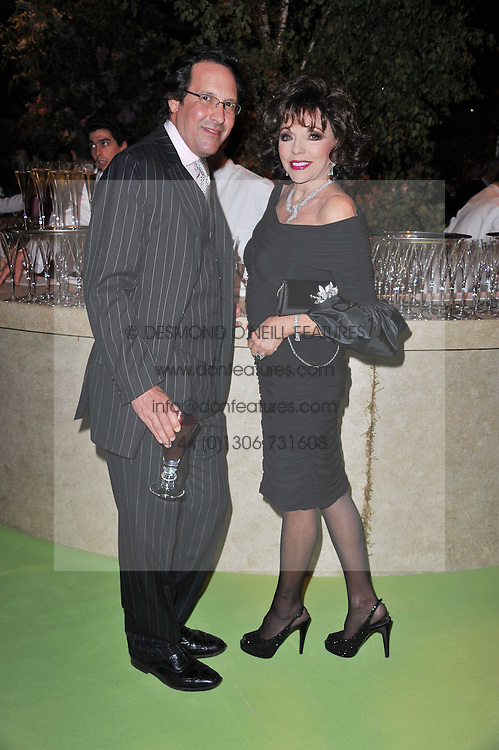 JOAN COLLINS and PERCY GIBSON at a dinner hosted by Cartier in celebration of the Chelsea Flower Show held at Battersea Power Station, 188 Kirtling Street, London SW8 on 23rd May 2011.