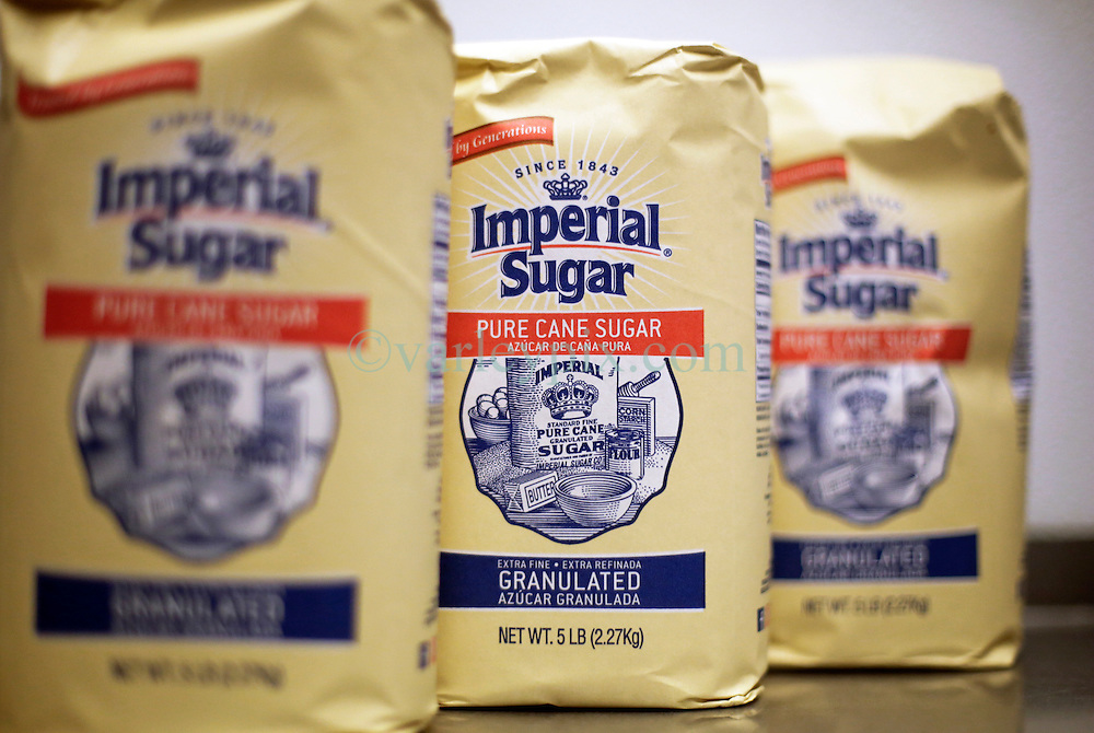 21 September 2015. New Orleans, Louisiana.<br /> Imperial Sugar sits on a shelf awaiting mixing to make Aunt Sally's Pralines.<br /> Photo©; Charlie Varley/varleypix.com