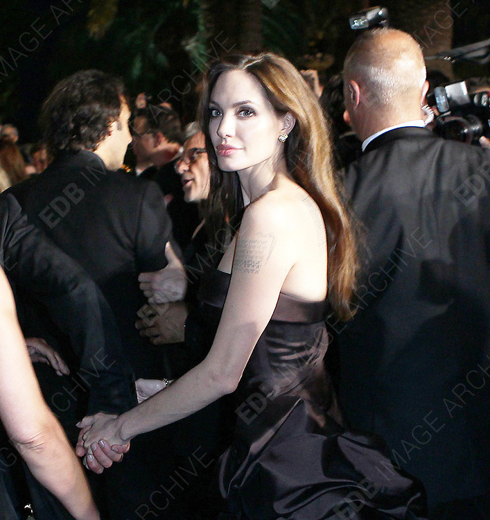 16.MAY.2011. CANNES<br /> <br /> BRAD PITT AND ANGELINA JOLIE LEAVING THE PREMIERE OF BRAD'S NEW FILM THE TREE OF LIFE AT THE 64TH CANNES INTERNATIONAL FILM FESTIVAL 2011.<br /> <br /> BYLINE: EDBIMAGEARCHIVE.COM<br /> <br /> *THIS IMAGE IS STRICTLY FOR UK NEWSPAPERS AND MAGAZINES ONLY*<br /> *FOR WORLD WIDE SALES AND WEB USE PLEASE CONTACT EDBIMAGEARCHIVE - 0208 954 5968*