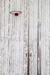 basketball hoop on a wooden barn