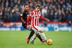 Bojan Krkic of Stoke City is challenged by Memphis Depay of Manchester United - Mandatory byline: Rogan Thomson/JMP - 26/12/2015 - FOOTBALL - Britannia Stadium - Stoke, England - Stoke City v Manchester United - Barclays Premier League - Boxing Day Fixture.