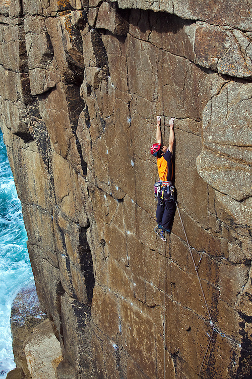 Toru Nakajima climbing 'Tears Of A Clown' E7 6c on-sight at Sennen, Cornwall, England