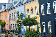 Quaint and colourful houses line the Danish street of Olufsvej in the Østerbro district of Copenhagen in Denmark