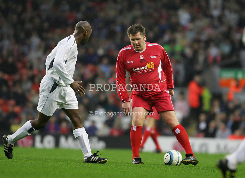 LIVERPOOL, ENGLAND - SUNDAY MARCH 27th 2005: Liverpool Legends' Jan Mølby and Celebrity XI's DJ Spoony during the Tsunami Soccer Aid match at Anfield. (Pic by David Rawcliffe/Propaganda)