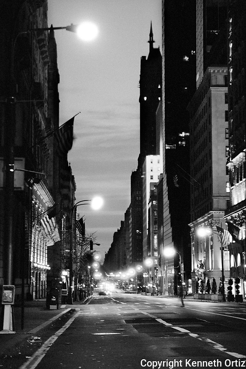 This is an early morning shot of 5th Avenue.  It was just at early day break and I came across this desolate view of 5th Avenue in Manhattan.  It was eerily deserted, except for the lone man crossing the street and a few cars off in the distance.