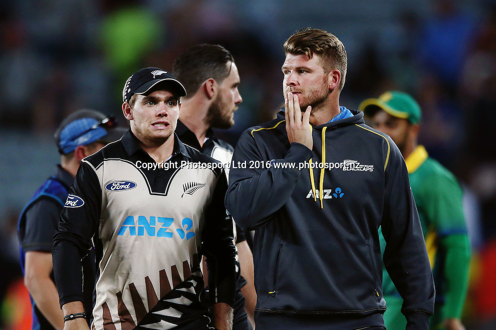 Corey Anderson and Tom Latham of New Zealand react after the defeat. ANZ International Series, Twenty-20 Match between New Zealand Back Caps and Pakistan at Eden Park in Auckland, New Zealand. 15 January 2016. Photo: Anthony Au-Yeung / www.photosport.nz