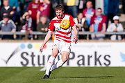 Doncaster Rovers defender Tom Anderson (12) with a long ball during the EFL Sky Bet League 1 match between Scunthorpe United and Doncaster Rovers at Glanford Park, Scunthorpe, England on 23 February 2019.