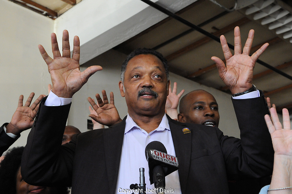 November 3, 2011 - Atlanta, Georgia: Reverend Jesse Jackson joins Occupy Atlanta members in the waving of hands which in OA culture usually means people are in agreement or are applauding a speaker.<br /> <br /> Occupy Atlanta hosted a press conference with Reverend Jesse Jackson at Peachtree-Pine, the downtown homeless shelter where members of Occupy Atlanta are currently staying on the 4th floor.<br /> <br /> Jackson touched on many issues ranging from &quot;the wealth gap to the health gap,&quot; and spoke about the two party system saying &quot;the two parties are not the same, we do have a choice,&quot; he also touched on issues of poverty, foreclosure, affordable housing and the forgiveness of student loans.