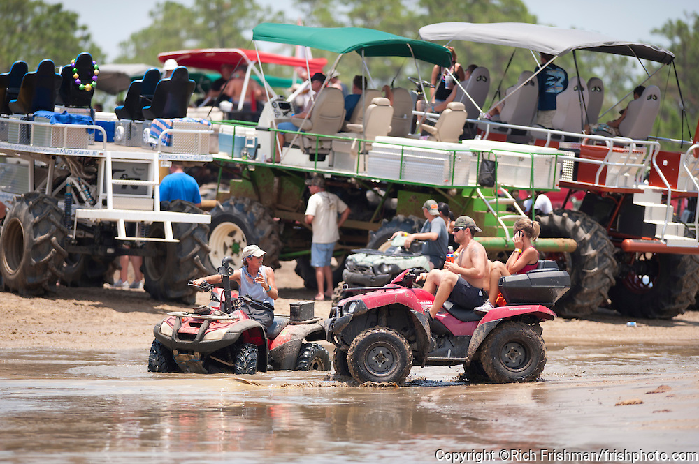 The Redneck Yacht Club was the 4th of July holiday destination for mudders and swampbuggy enthusiasts. Developer Danny Kelly, owner of the private club, spent over 2 years and $1 million to transform an 800-acre potato farm into the perfect mud pit, which opened in February 2009. While the region's real estate market is among the worst in the nation and foreclosures are at record levels, thousands of muddin' fanatics are flocking to race their custom-built swamp buggies through Kelly's muck and mire outside Punta Gorda in west Florida. ..©Rich Frishman..
