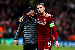 Jordan Henderson and Adam Lallana of Liverpool celebrate victory over Barcelona to make the Champions League Final - Mandatory by-line: Robbie Stephenson/JMP - 07/05/2019 - FOOTBALL - Anfield - Liverpool, England - Liverpool v Barcelona - UEFA Champions League Semi-Final 2nd Leg