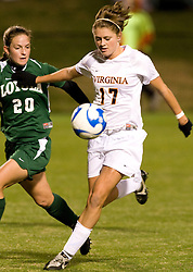 Virginia Cavaliers midfielder/forward Sinead Farrelly (17) fights Loyola defender Amanda Meehan (20) for possession.  The Virginia Cavaliers defeated the Loyola (MD) Greyhounds 4-1 in the first round of the NCAA Women's Soccer tournament held at Klockner Stadium in Charlottesville, VA on November 16, 2007.