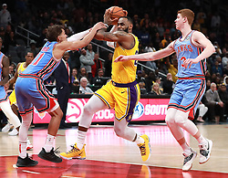 February 12, 2019 - Atlanta, GA, USA - Atlanta Hawks guards Trae Young and Kevin Huerter double-team Los Angeles Lakers' LeBron James during the second half in the final minutes of a 117-113 victory on Tuesday, Feb. 12, 2019 in Atlanta, Ga. (Credit Image: © Curtis Compton/Atlanta Journal-Constitution/TNS via ZUMA Wire)