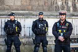 © Licensed to London News Pictures. 02/12/2019. London, UK. Police at pay their respects during the Vigil at the Guildhall London for the victims of the London Bridge attack on Friday 29/11/2019. Photo credit: Alex Lentati/LNP