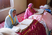 "At  Gurdwara Siri Punja Sahib Temple in Hasanabdad, more than 450 Sikh families have sought shelter from the recent fighting between militants and government forces in the Buner and SWAT districts if Pakistan...According to Dr Suran Singh, the 'Camp in Charge' person for the temple, the Sikh community fled and sought shelter at the Sikh temple not because of fear and persecution by the Taliban but because of the bombing and shelling by government forces on nearby houses and businesses. He said it was in everyone's interest to leave during the curfew periods dictated by the military as the fighting would inevitable cost innocent lives and those who stayed would not be able to survive because all businesses in the areas had closed. He emphasised that they had no quarrel with the Taliban and had not been forced to leave the area by militant forces...The Gurdwara Siri Punja Sahib Temple has some 305 rooms able to accommodate families with others being accommodated in adjoining areas of the temple. Dr Suran Sign praised the assistance that had been offered by both the local Muslim community, UNHCR and the government. He said they had been given medical provisions, bedding, clothing and resources to provide an ongoing education to the children at the temple...D Signh said the residents main concern was the destruction and arson of the local bank in his town which he claims had no computerised system. Many in the Sikh community had their life savings deposited with the bank, they now fear that the money has been either looted or destroyed with little in the way of proof to show for the savings they once had...Most people like 54 year old Mr Manjeet Singh had evacuated his family of 5 form SWAT on the 3rd of May. He also praised the facilities and efforts of the temple, saying that they had no immediate needs for IDP aid at the moment. He said his family was content living at close quarters in this self contained community but ""home is home' - he prayed that the fighting wo"