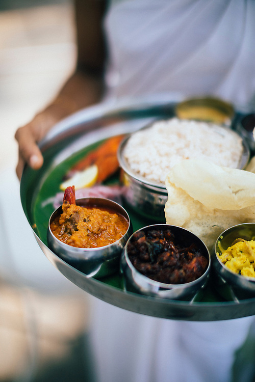 Fort Kochi, India -- February 13, 2018: A set thali lunch--with spice rubbed fish and several curries--at the Brunton Boatyard.