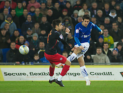 CARDIFF, WALES - Tuesday, February 1, 2011: Cardiff City's Peter Wittingham gets his shot pass Reading's Jem Karacan during the Football League Championship match at the Cardiff City Stadium. (Photo by Gareth Davies/Propaganda)