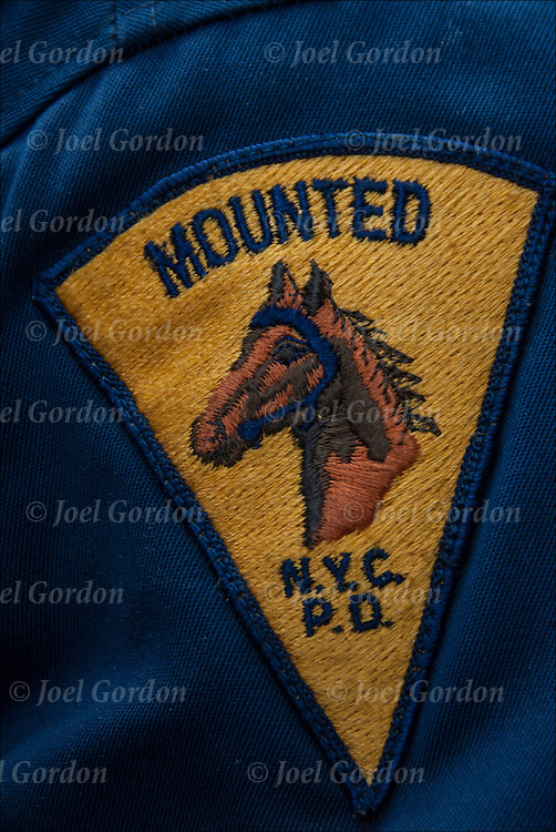 Close up NYPC Mounted Police emblem patch on officer's uniform.