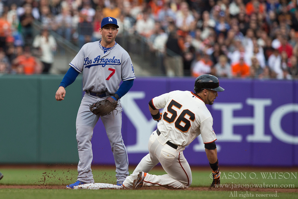 SAN FRANCISCO, CA - MAY 05: Andres Torres #56 of the San Francisco Giants slides into second base in front of Nick Punto #7 of the Los Angeles Dodgers during the first inning at AT&T Park on May 5, 2013 in San Francisco, California. The San Francisco Giants defeated the Los Angeles Dodgers 4-3. (Photo by Jason O. Watson/Getty Images) *** Local Caption *** Andres Torres; Nick Punto