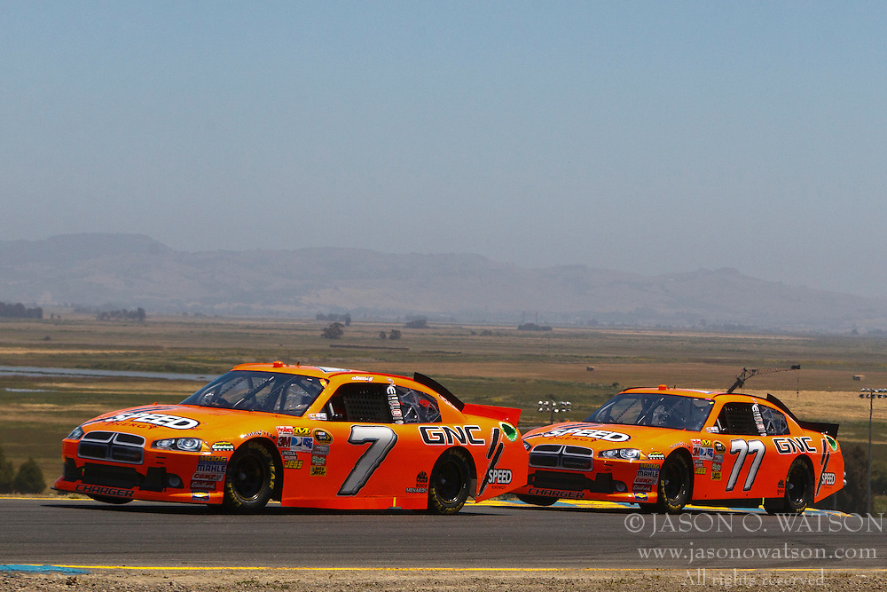 June 26, 2011; Sonoma, CA, USA;  NASCAR Sprint Cup Series driver Robby Gordon (7) and driver Steve Wallace (77) in turn 2 during the Toyota/Save Mart 350 at Infineon Raceway.