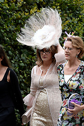 Former Prime Minister Tony Blair's Son Euan Blair Wedding to Suzanne Ashman at All Saints Church in  Wotton Underwood, United Kingdom. Saturday, 14th September 2013. Picture by Ben Stevens / i-Images<br /> <br /> Picture are guests arriving at the wedding.