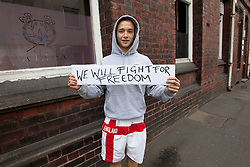 © Licensed to London News Pictures. 13/08/2011. Telford, UK. An EDL supporter. The EDL demonstrate against a paedophile ring in the small Telford town of Wellington. The group were going to march, however the Home Secretary imposed a ban on all marches in the area. About 300 EDL supporters attended. The EDL demonstration was counter-protested by about 300 people. Photo credit : Joel Goodman/LNP