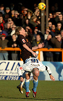 Photo: Ian Hebden.<br /> <br /> Barnet FC v Wycombe Wanderers. Coca Cola League 2. 21/01/2006.<br /> <br /> Barnets Clint Easton (Top) Beats Wycombes Tom Mooney to the ball