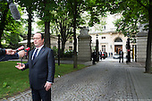 Pres Hollande at the Emb & flag at half mast