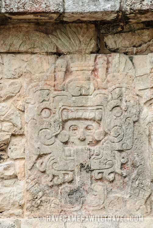 Carving of a Mayan warrior at Chichen Itza Archeological Zone, Mexico