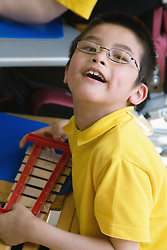 Child with Cerebral Palsy in a music lesson,