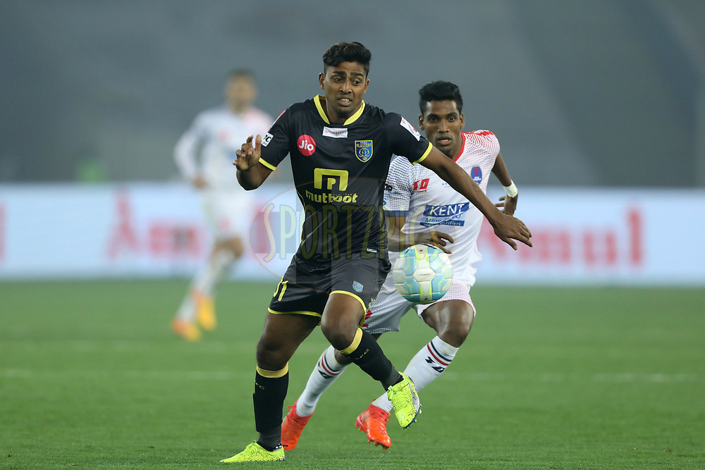 Rino Anto of Kerala Blasters FC and Nandhakumar Sekar  of Delhi Dynamos FC in action during match 43 of the Hero Indian Super League between Delhi Dynamos FC and Kerala Blasters FC  held at the Jawaharlal Nehru Stadium, Delhi, India on the 10th January 2018<br /> <br /> Photo by: Arjun Singh  / ISL / SPORTZPICS