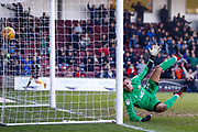 Doncaster Rovers goalkeeper Marko Marosi (13) is beaten by Scunthorpe United forward Kyle Wootton (29) (not shown) header to go 1-1 during the EFL Sky Bet League 1 match between Scunthorpe United and Doncaster Rovers at Glanford Park, Scunthorpe, England on 23 February 2019.