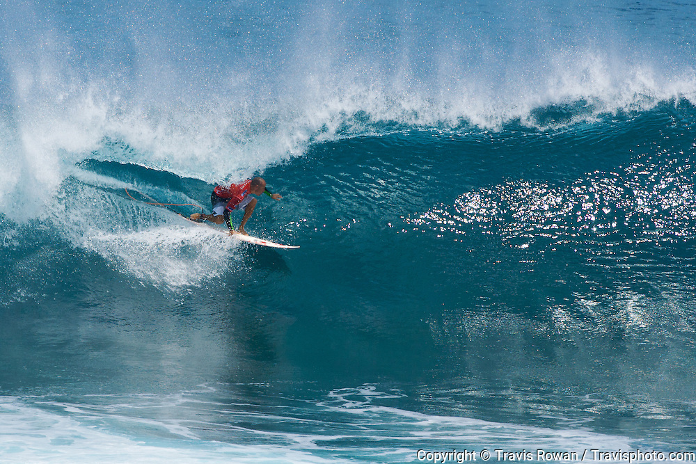 Professional surfer Kelly Slater pulling into a barreling wave in Bali during the Rip Curl Pro Search 2008.