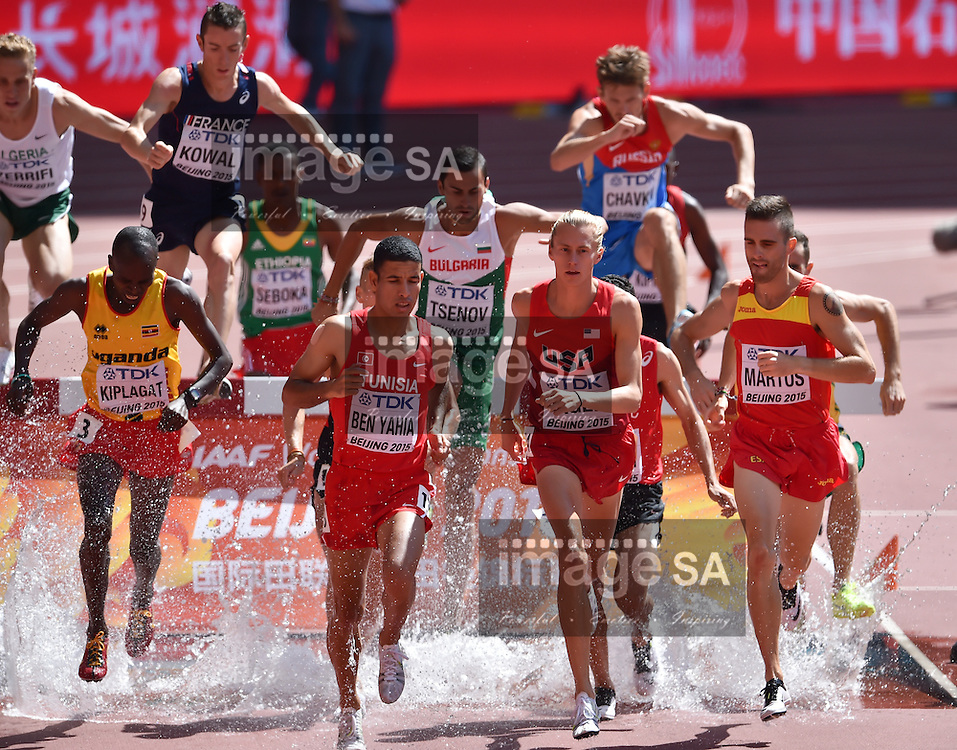 BEIJING, CHINA - AUGUST 22: Benjamin Kiplagat (Uganda), Amor Ben Yahia (Tunisia), Evan Jager (USA) and Sebastian Martos (Spain) in Round 1 of the mens 3000m steeplechase during day 1 of the 2015 IAAF World Championships at National Stadium on August 22, 2015 in Beijing, China. (Photo by Roger Sedres/Gallo Images)