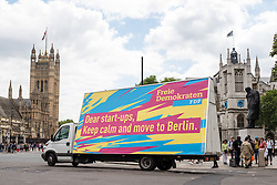 © Licensed to London News Pictures. 05/07/2016. London, UK. A van drives an advert around central London urging British startups to relocate to Berlin in the wake of Britain's decision to leave the European Union. The advert was put out by Germany's Free Democratic Party (FDP). Photo credit: Rob Pinney/LNP