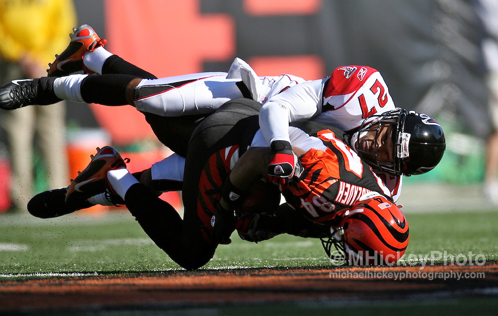 Atlanta's Jason Webster puts the tackle on Cincinnati's TJ Houshmandzadeh after a reception during action at Paul Brown Stadium in Cincinnati, Ohio on October 29, 2006. The Falcons defeated the Bengals 29-27.