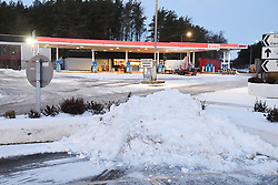 © Licensed to London News Pictures. 17/01/2018. Tebay, UK. Snow is piled up at Tebay services after heavy overnight snow. Photo credit: John France/LNP