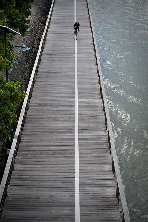 The South Bank by the Brisbane River, Brisbane, Queensland, Australia..Photo shows the Boardwalk along the river that was partially destroyed during the 2010 floods.