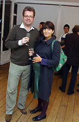CLAUDIA WINKLEMAN and CHARLES PHILLIPS at an exhibition of artist Jonathan Yeo's portrait paintings held at Eleven, 11 Eccleston Street, London SW1 on 16th February 2006.<br />