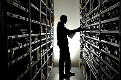A worker takes inventory in a warehouse. (Photo © Jock Fistick)