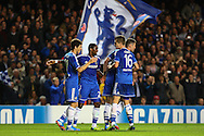 Picture by Daniel Chesterton/Focus Images Ltd +44 7966 018899<br /> 18/09/2013<br /> Oscar of Chelsea (left) celebrates with teammates after scoring Chelsea's first goal during the UEFA Champions League match at Stamford Bridge, London.