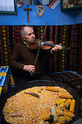 Dumbreveni village, Ui Rekecsin in Hungarian, a man plays violin in the kitchen of his house. For the csango people music is literally part of the life.
