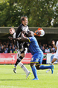 Roy Carroll (Goalkeeper and Captain) and Bayo Akinfenwa of AFC Wimbledon colide during the Sky Bet League 2 match between AFC Wimbledon and Notts County at the Cherry Red Records Stadium, Kingston, England on 19 September 2015. Photo by Stuart Butcher.