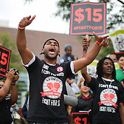 Representing the NYC Fast-Food Workers' Campaign, Jorel Ware of the Bronx, rallies with supporters of raising fast-food workers' wages at Nassau Community College in Garden City Thursday, June 18, 2015.
