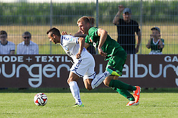 18.07.2014, Sportplatz Jettingen, Jettingen, GER, FS Vorbereitung, Karlsruher SC vs FC Augsburg, im Bild l-r: im Zweikampf, Aktion, mit Manuel Torres #18 (Karlsruher SC) und Ragnar Klavan #5 (FC Augsburg) // during a Friendly Match between Karlsruher SC and FC Augsburg at the Sportplatz Jettingen in Jettingen, Germany on 2014/07/18. EXPA Pictures © 2014, PhotoCredit: EXPA/ Eibner-Pressefoto/ Kolbert<br /> <br /> *****ATTENTION - OUT of GER*****